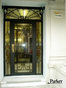 CUSTOM IRON SINGLE DOOR WITH SIDE PANES AND TRANSOM