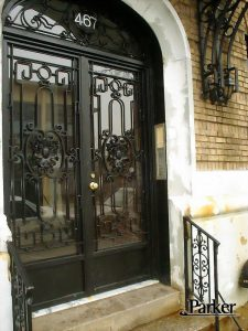 CUSTOM IRON DOUBLE DOOR WITH ARCH TRANSOM