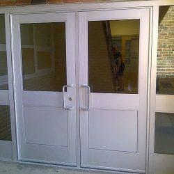 Pair wide stile clear anodized aluminum/glass doors