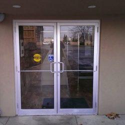 Pair medium stile clear anodized aluminum/glass doors